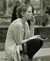 Troubled And Concerned (swong95765) Tags: pondering girl female lady woman smoking phone sitting thinking break alone concern thoughts smoker