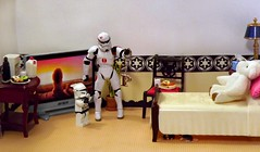 A Little Bling on the Death Star (ChicaD58) Tags: dscf8695b starwarsactionfigure actionfigure stormtrooper clonetrooper lego palpatinesnephew stb stormtrooperbruce zoraktheteddybear teddybear tv plant chair bed endtable tissue lamp necklace bling pnecklace donuts milk coffeemaker commemorativedarthbottleofscotch mice
