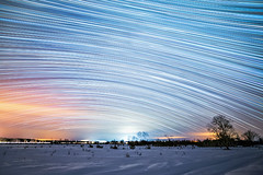 Winter Star Trails (Matt Molloy) Tags: mattmolloy timelapse photography timestack photostack movement motion night sky stars trails lines clouds trees winter snow field countryside violet ontario canada landscape lovelife