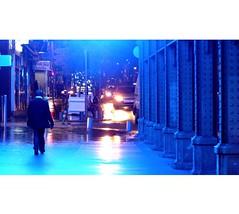 Out of the blue (borisvasilev) Tags: person walking urban city lights blue blues nice france night street color streetincolour streetphotography digitlphotography construction noflash walk panasonic car emotion travel column