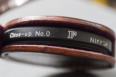 F Nikkor, my favorite letter (Arne Kuilman) Tags: nikon nikkor closeupno0 diopter 07 leather case original nikonf f macro filter closeup
