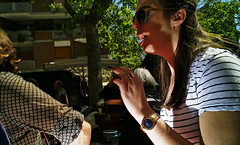 Mid conversation. (Baz 120) Tags: candid candidstreet candidportrait city candidface candidphotography contrast colour street streetphoto streetcandid streetphotography streetphotograph streetportrait rome roma romepeople romestreets romecandid europe women monochrome monotone mono blackandwhite bw noiretblanc urban voightlander12mmasph life leicam8 leica primelens portrait people unposed italy italia girl grittystreetphotography flashstreetphotography flash faces decisivemoment strangers