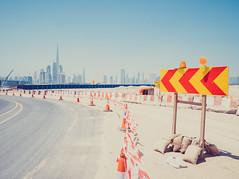 Dubai (miemo) Tags: burjkhalifa dubai middleeast uae unitedarabemirates arrows bend construction curve direction downtown em5mkii landscape olympus olympus1240mmf28 omd road sand skyline skyscrapers trafficsign travel ae