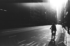 Acros 100 (Wilson Au | 一期一会) Tags: fujifilm neopan acros blackandwhite film bw leica letiz leicam3 35mm summaron backlight street shadow silhouette leitz35mmf28summaron 100 bicycle bike flare glow defect man 背光 hongkong westerndistrict 香港 西環 街道