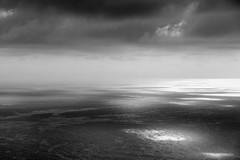 Silver seas (2016) (Kai van Reenen) Tags: sea sundown sunset silver sky skies dark basque san sebastián spain kai van reenen canon eos 550d 1585mm gulf biscay meer monochrome monochroom einfarbig zwarz und weiss blackandwhite black white zwart wit zwartwit photography photo fotografie minimal landscape seascape view birdseye stormy bnw clouds