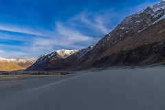 evening in Himalayas (Mijan Rashid) Tags: valley nubravalley nubra india sand dune sanddune landscape ladakh leh sky evening mountain ice snow mountains bharat asia asian southasia clouds cloud canon canon1100d 1100d canon1100 tamron tamron18270mm tamron18270 travel travelphotography outdoor 18270mm shadow blue bluesky white rocks march march2017 road kashmir jammukashmir diskit dusk himalayas