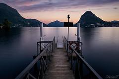 Lugano (nicolas.fernandez85) Tags: longexposure lugano sunset suisse switzerland lake water colour mountain waterscape dusk spring beautiful clouds pier svizzera schweiz ticino evening sun sky lighthouse reflection