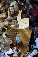 (darkWhiteYeti) Tags: reflection scrap recycling metal pipe pipes valve gold blue discarded