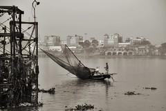 Kolkata, India (paola ambrosecchia) Tags: kolkata india light boat river fisherman city sky skyline amazing blackandwhite monochrome