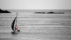 The red sail, Brittany France (filippi antonio) Tags: rotheneuf armor côtedarmor brittany bretagne bretagna breizh francia france sea water ocean atlantic seascape waterscape boat rocks blackandwhite canon outdoor selectivecolor colorsplash