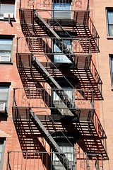 Tenement (WalrusTexas Offline) Tags: brick window wall fireescape stair tenement manhattan