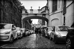 rain in rome (Dave (www.thePhotonWhisperer.com)) Tags: rome walk umbrella cars arch vacation travel