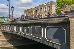 Life on a bridge (stevefge) Tags: camden london uk reflectyourworld people candid bridges canal street crossing cap streetlight