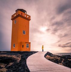 Svortuloft lighthouse - Iceland - Travel photography (Giuseppe Milo (www.pixael.com)) Tags: iceland girl landscape travel woman lighthouse yellow orange raincoat westernregion is onsale portfolio