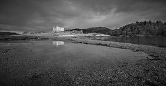 Castle Tioram, West Scotland (dandraw) Tags: castletioram ardnamurchan westscotland scotland outdoors castle goldenhour sunlight reflection reflections mirrorimage sky clouds blackandwhite mono monochrome nikon d7100