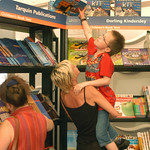 Stretching for a book at the 2003 Edinburgh International Book Festival