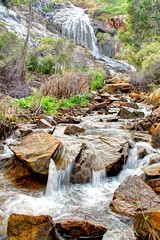 Lesmurdie Falls (Marie Ooi) Tags: winter nature water beautiful forest canon waterfall rocks stream peaceful hills perth serenity wa flowing splash hillside westernaustralia silky 500d lesmurdie perthhills marieooi