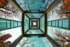 Looking Up in the New England Holocaust Memorial, Union Street Boston (Greg DuBois - Sponsored by LEE Filters) Tags: lighting blue trees shadow red sky urban sculpture usa color green tower fall geometric glass up boston metal architecture modern clouds contrast canon reflections photography vanishingpoint high cool october memorial warm unitedstates angle distorted cloudy steel massachusetts towers wide perspective streetphotography structures newengland naturallight wideangle structure historic lookingup lookup fisheye tall 8mm hdr northend unionstreet northendboston wideview greenglass newenglandholocaustmemorial samyang warmcoolcontrast bostonneighborhood 8mmsamyang gregdubois unionstreetboston gregduboisphotography