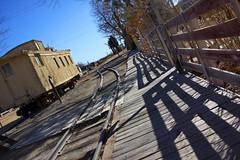 Tracks and Shadows (lefeber) Tags: california railroad train town vanishingpoint shadows traintracks tracks angles roadtrip caboose sidewalk depot boardwalk traincar railing ruraldecay laws angled owensvalley railroadcar