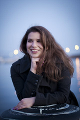 On the dock. {11/52} (Katja Gavric) Tags: blue winter sunset sea portrait woman girl smile night canon hair eos 50mm bay dock hands afternoon view purple bokeh f14 coat teeth ef 40d