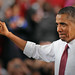 "President Barack Obama flashes the ""wuf"" sign after speaking on the NC State campus."