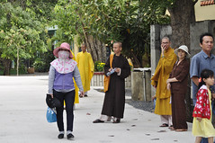 At the temple (Roving I) Tags: worship religion buddhism vietnam monks temples protection robes vungtau beliefs sunhats facemasks