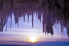 Sunset Through Ice (Light Brigading) Tags: sunset sky sun lake snow ice wisconsin clouds nbc frozen superior caves ashland bayfield icycles