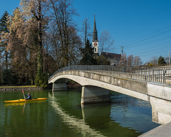 LOR600 Pedestrian Bridge over the Lorze River, Hirsgarten - Villette Park, Cham, Canton of Zug, Switzerland (jag9889) Tags: cham lakezug church bridge river 20170317 cantonzug lorze footbridge switzerland concrete europe spire kayaking 2017 6330 bach beton bridges bruecke brücke ch cantonofzug crossing fluss fussgängerbrücke gkz676 helvetia infrastructure kantonzug kayak kayaker outdoor paddling pedestrianbridge pont ponte puente punt reuss reusstributary schweiz span structure suisse suiza suizra svizzera swiss waterway zg zug zugersee jag9889