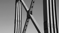 Lisboa (No Great Hurry) Tags: rectangle oblong portugal robinmauricebarr nogreathurry architecturalabstract architectural abstract lisbon lisboa bridge noiretblanc blackandwhite filmnoir monochrome minimal minimalistic rivets structure steel steelwork mood atmospheric atmosphere 25deabrilbridge géométrie robin ngh perspective building creative
