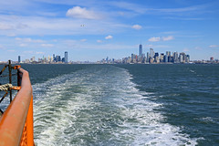 Two Sides (the_orl) Tags: new york city sky sea america ferry stream skyline one world trade manhatten empire state mind weather clouds sun