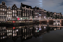 Night Shift (McQuaide Photography) Tags: amsterdam noordholland northholland netherlands nederland holland dutch europe sony a7rii ilce7rm2 alpha mirrorless 1635mm sonyzeiss zeiss variotessar fullframe mcquaidephotography adobe photoshop lightroom tripod manfrotto light licht night nacht nightphotography longexposure stad city capitalcity urban lowlight architecture outdoor outside old oud gracht grachtenpand canalhouse house huis huizen traditional authentic water reflection centrum gebouw building waterfront waterside canal boat boot wideangle groothoek wideanglelens singel redlight redlightdistrict singelgebied windows bridge brug unesco heritage