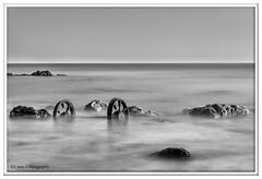 Wheels in mono (Lynne J Photography) Tags: pier sunrise pastel long exposure beach rapeseed dusk sunset chemicalbeach seaham wheels sand steetley dawn colors rocks sidelight