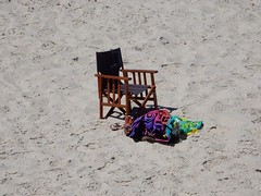 Chair at the Centre (mikecogh) Tags: grange beach chair empty centre center context sand towels