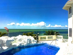 Stunning View From Drawing Room Of Blessed Home - IMRAN™ (ImranAnwar) Tags: apollobeach architecture blessed clouds flag florida horizon imran imrananwar iphone iphone6splus lifestyle luxury palmtrees sky swimmingpool tampabay usa water waterfront whitehouse
