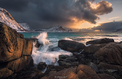 Haukland Happy Hour (Ron Jansen - EyeSeeLight Photography) Tags: haukland nordland lofoten norway sunset orange blue water sea ocean rock rocks wave waves splash action drama sky mood moody snow light d810 nikonafsnikkor1424mmf28ged backlight