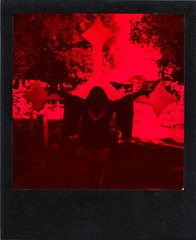 SPD_Polaroids-6 (MrAnathema) Tags: plaguedoctor cemetary black red impossibleproject impossible onestep monochrome impossiblemonochrom crosses girl plague doctor goth gothic graveyard arizona polaroid polaroidpicture instantfilm instantphotograph instantpicture blackframe