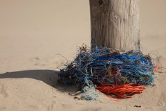 Tied up (peeteninge) Tags: rope touw fishingnet visnet orange oranje blue blauw paal pole beach strand zand sand sonyrx10 sony