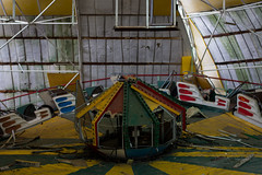 One more ride? (modestmoze) Tags: colorful ride carousel lithuania 2017 500px indoors inside colors abandoned old damaged amusementpark amusement park walls tiles wrecked lines metal yellow red blue white green grey falling spring april view urbanexploring urban exploring travel
