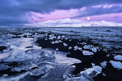 Moonset at Ice Beach (jeanineleech) Tags: diamondicebeach icebeach jökulsárlón blacksand streaks water waves fullmoon moonset moon dawn twilight frost blacksandbeach morning ice icebergs clouds outdoor iceland