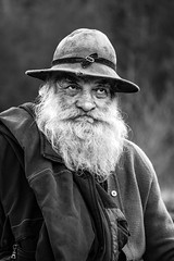 Portrait of a Traveler (WhiteShipDesign) Tags: gypsy traveler beard authentic vintage hat leather textures male old portrait face person senior grandfather hair white adult father sad closeup mature aged man human elderly wisdom black moustache people age thinking expression retirement retired blackandwhite monochrome