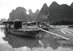 Li River - boats at shore at Xingping 1993 (Bruce in Beijing) Tags: china guangxi yangshuo xingping liriver riverboats ferryboats riverlife transport 1993 monochrome