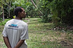 Alfred Masul of Numuru walks through his village. (UNDP Papua New Guinea) Tags: mangroves papuanewguinea png environment madang disasterriskreduction undp coast conservation alfred masul numuru