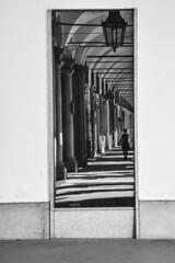 Riflesso o realtà - Reflection or reality. (sinetempore) Tags: riflessoorealtà reflectionorreality biancoenero blackandwhite torino turin piazzacastello specchio mirror street donna woman portici arcade porches luce light ombra shadow