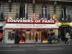 . (RubyGoes) Tags: paris france tourists pedestrians lights balconies building shop souvenirs red white windows yellow