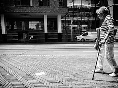 Passing By (Streetlife) (Mark Kerkhoff) Tags: street camera bw monochrome zwartwit streetphotography streetlife denhaag oldlady ricoh thehague straat passingby ricohgrdigitalii