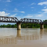 The infamous Bridge over the River Kwae seen from the nearby floating restaurant, Kanchanaburi, Thailand thumbnail