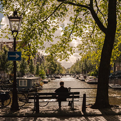 Sitting and Reading (lennox_mcdough) Tags: city bridge cloud holland tree netherlands amsterdam bike canon bench eos boat canal nederland lamppost shade arrow gracht reddit 5dmarkii ef40mmf28stm takenin2013