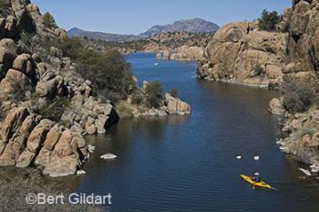 Granite Mountain backdrops Watson Lake & kayaker