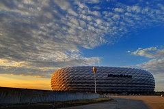 Allianz Arena Bathed in Sunset Lights (jerryjcwu) Tags: travel sunset summer germany munich landscape football scenery europe nikkor allianzarena d600 nikonafsnikkor1835mmf3545ged vision:mountain=0717 vision:sunset=0693 vision:sky=099 vision:outdoor=0937 vision:clouds=0969