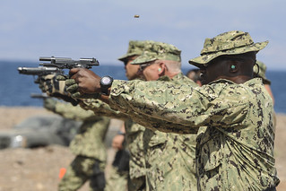Sailors fire M9 pistols in Djibouti.
